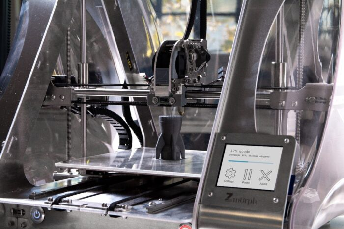 A 3D printer creating a prototype