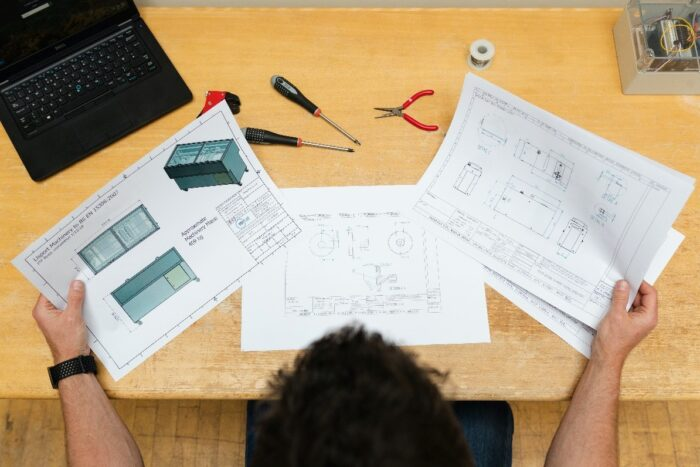 An engineer looking at different designs for a project