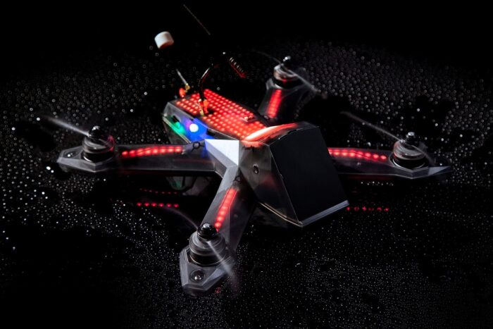A black drone packed in a red LED light packaging