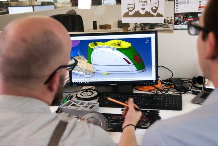 Man using a CAD tool to design an electric scooter